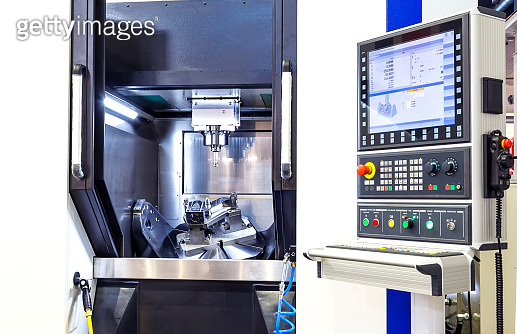 Modern CNC machine control panel. Shallow depth of field.