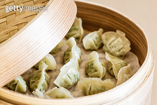 Asian gyoza, dumplings snack, chopsticks, steamer