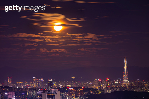 Seoul City SkyLine at night and full moon in Seoul South Korea.