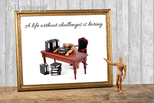wooden mannequin motivating quotes - A life without challenges is boring - sleeping on desk