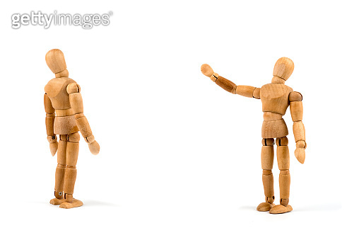 Wooden mannequin showing something on background - add your own text