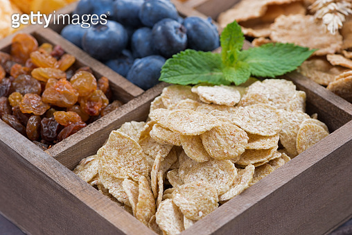 breakfast cereal and other ingredients in a wooden box