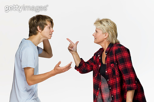 Generation gap. Male teenager is arguing with his mother