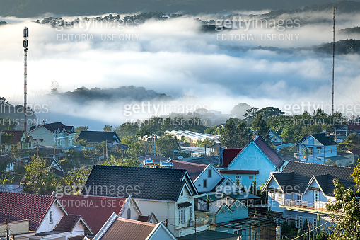 Landscape of houses on the mountain on a foggy day in the early morning at Da Lat, Vietnam