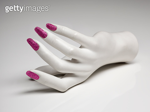 mannequin hand with perfect manicure and pink nail polish