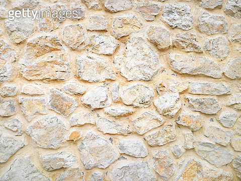 Background from the wall built from large natural stone. Texture