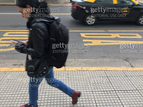 Using cellphone while walking in the street,