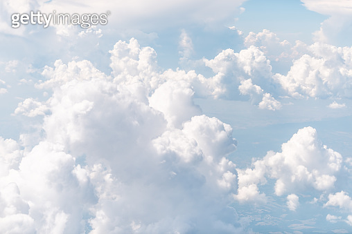 Isolated sky cloudscape with fluffy clouds and bright soft sunny sunlight aerial view of Italy from airplane