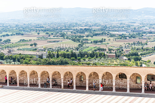 Town or village city in Umbria, church arches path aerial view down during sunny summer day, nobody, farm rural landscape Etruscan countryside