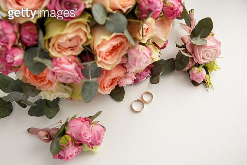 Wedding rings near wedding bouquet