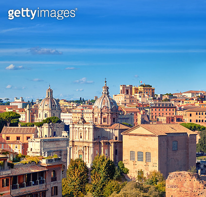 Beautiful view of Roman Forum and church cupola in Rome, Italy