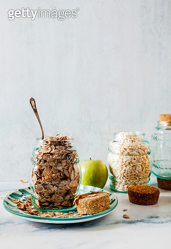 Variety of cold quick breakfast cereals in glass jars , healthy eating for kids and athletes. concept of a healthy lifestyle. gluten-free diet