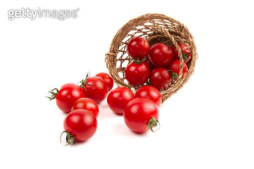 Tomato in basket isolated white background