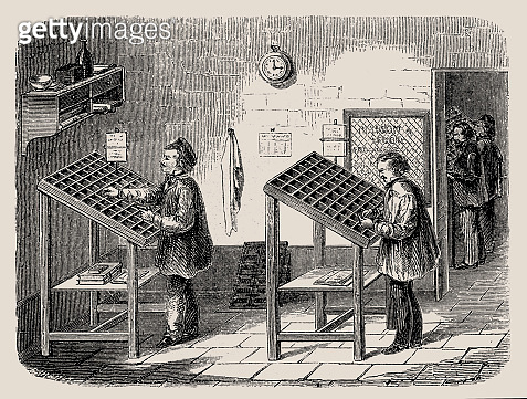 Men working at type-cases