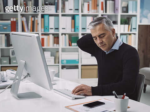 Office worker with neck pain