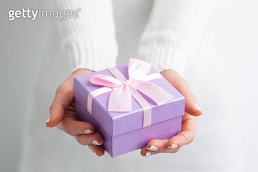Gift box on woman hands