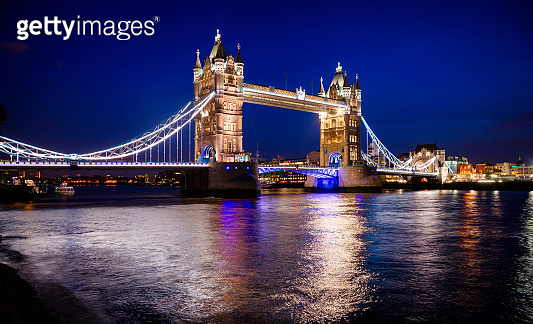 London cityscape with illuminated Tower Bridge over the River Thames