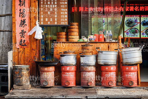 Cooking pots and Dim Sum baskets outside restaurant, China