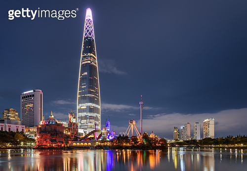 Amazing night view of skyscraper by lake at downtown, Seoul