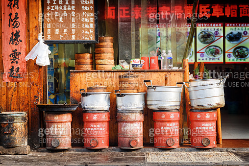 Cooking pots and Dim Sum baskets outside Chinese restaurant