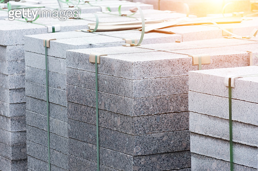 Marble slabs, paving stones, building material on pallets.