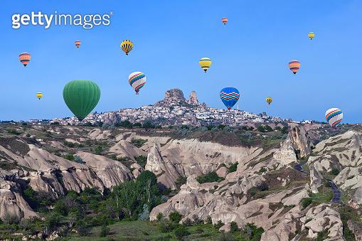 Hot air balloons flying over Cappadocia, Anatolia, Turkey