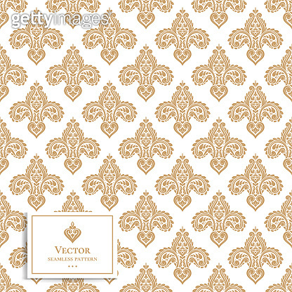 Gold and white vintage seamless pattern. Paisley elements.