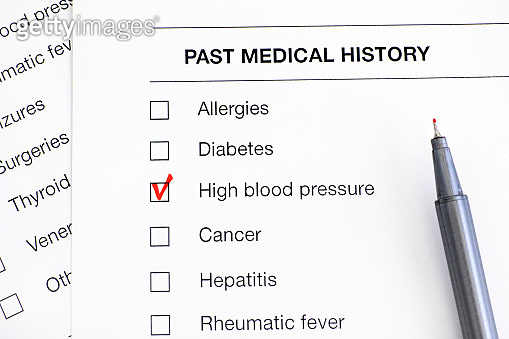 Past medical history questionary with ticked High Blood Pressure and pen.