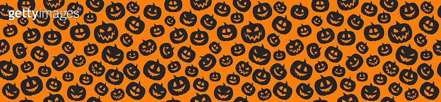 Halloween - seamless texture with funny pumpkins. Vector.