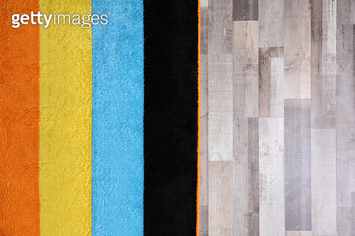 Colorful striped carpet on wooden floor
