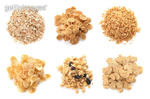 Set with breakfast cereals on white background, top view. Healthy whole grain recipe