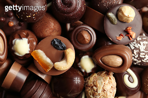Many different tasty chocolate candies as background