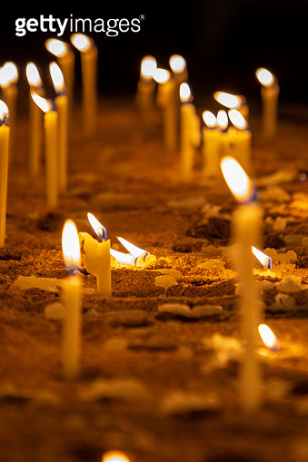 Candles in a church in memory of the dead and saints.
