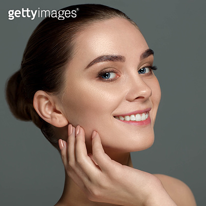 Portrait woman with fresh clean face and wide eyebrows.