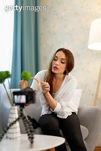 Fashion Blogger Filming Video On Camera At Home