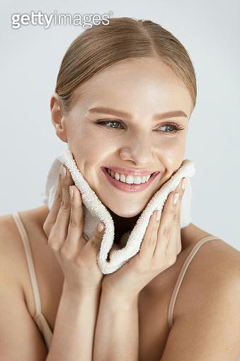 Cleaning Face Skin. Beautiful Happy Girl Washing Face