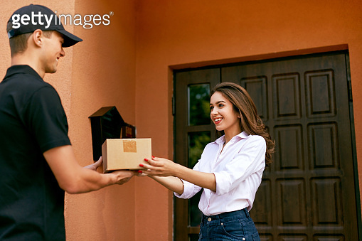 Express Delivery Service. Courier Delivering Package To Woman