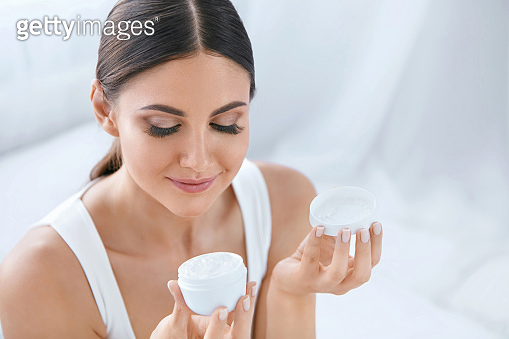Skin Care. Woman With Natural Face Beauty Holding Facial Cream