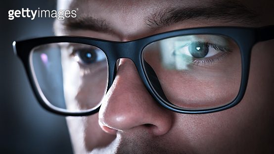 a378e6097ad Glasses with light reflected from computer or smartphone screen. Thoughtful business  man or focused student
