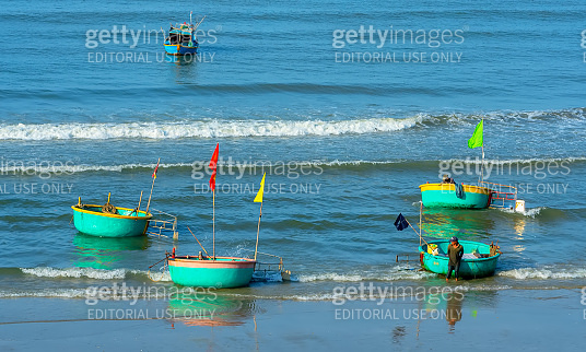 Pier fishing at Mui Ne beach in the morning when the fishermen prepare for a trip out to sea