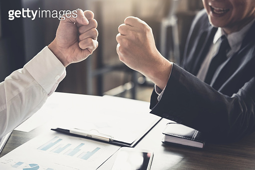 Teamwork of businessman partnership giving fist bump to greeting start up business strategy project