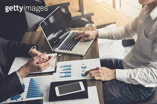 Business people are working in office, presentation in front of boss, businessman leader presentation to colleagues and business strategy and pointing to the graph and chart