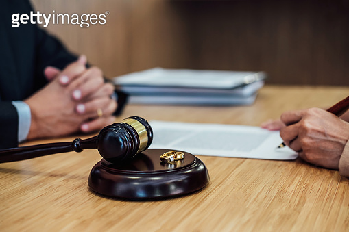 Marriage divorce on Judge gavel deciding, Consultation between a Businesswoman and Male lawyer or judge consult having signing divorce documents, Law and Legal services concept