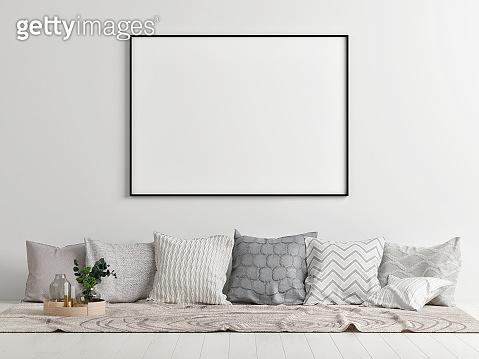 Mock up poster, pillows on the floor, comfortable Scandinavian interior concept