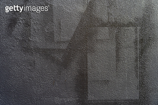 Abstract background from black color painted on grey concrete. Retro and vintage background.