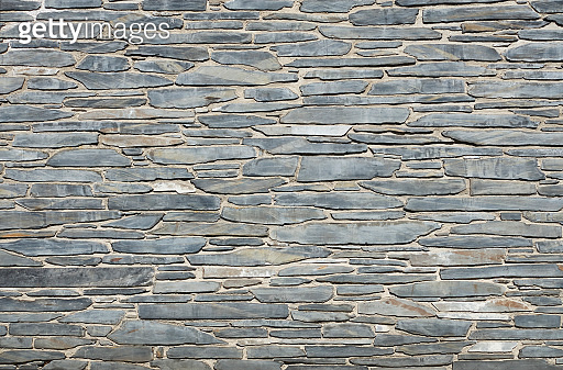 Photograph of a schist stone wall