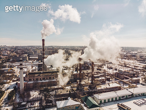 aerial view of smog pollution from city factory