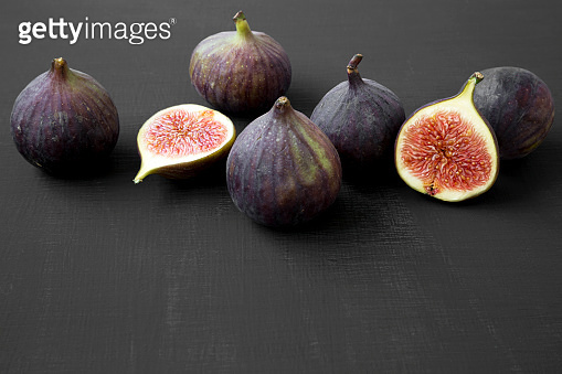 Fresh figs on black background, side view. Closeup.