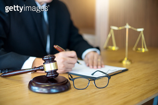 lawyer or  judge work in the office with gavel