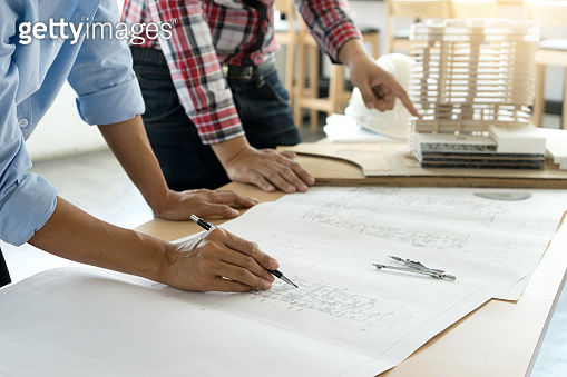 architect or engineer working on table show work